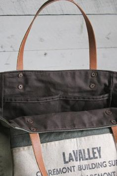 Sturdy canvas in various shades of olive green all salvaged from WWII era US military duffel bags have been combined and reworked into a great every day tote ba