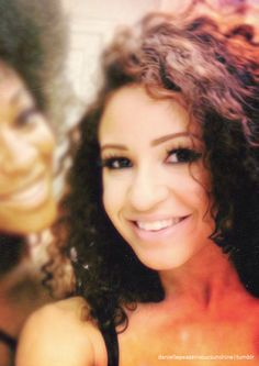 Danielle. she is a beautiful girl. i wish i knew what she used in her hair cuz mine is naturally like hers.