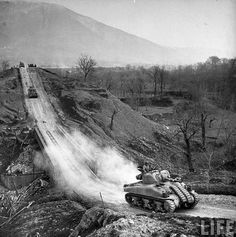 American Sherman tanks rumble across an Allied-built bridge during the push to take the town of Cassino, Italy, George Rodger—The LIFE Picture Collection/Getty Images The Real World, World War Two, Tank Warfare, Ww2 Photos, Ww2 Pictures, Army Sergeant, Sherman Tank, Ww2 Tanks, Panzer