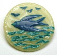 Vintage celluloid bird picture button