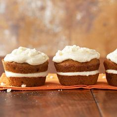 Pumpkin Cupcakes with Spiced Mascarpone Cream Filling | BHG | Delightful fall flavors -- brown sugar, walnuts, cinnamon, and nutmeg -- meet canned pumpkin in these so-soft sandwiched pumpkin cupcakes. Fill and top the luscious pumpkin dessert with our creamy homemade mascarpone spread.