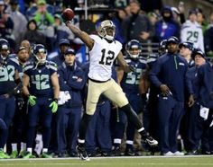 Marques Colston thrrew an illegal forward pass to end the game against the Seahawks.