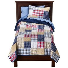 I REALLY want this for the boys bedroom. They're bedding is horrible! Asking for gift cards etc for the boys from Target for Christmas. I want to surprise them with a fresh look in their room for Christmas. Its a look that can grow with them!    Circo® Boy Plaid Collection