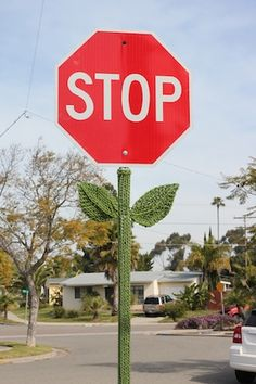 Yarn-bombed stop sign - This makes me grin every time I look at it. Seriously. :-D It's just so ridiculously happy! Even obnoxious stop signs (they're meant to catch your attention - they have to be obnoxious) can be pretty flowers. Is there anything happier than that??