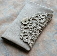 doily + some fabric.  Bet if I google a tute on how to make a clutch, I could do this.