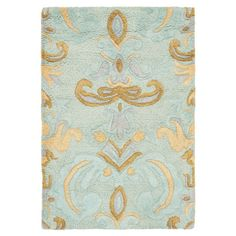 Stylishly anchor your living room or master suite with this lovely rug, showcasing an elegant scroll motif on a light blue background.