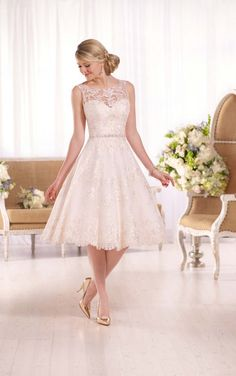 D2101 - This exquisite embroidered knee-length wedding gown from Essense of Australia is made from gorgeous lace on tulle, and features a pretty lace illusion neckline and back. A Diamante-encrusted band slims the waist, and the back zips up under coordinating fabric-covered buttons. Colors available - Ivory, White, Ivory/Almond