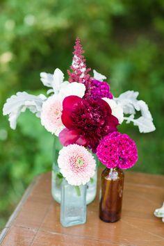 Easy magenta wedding flowers in a vase.