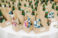Goody box wedding favour including bear, crisps, sweets and chocolate bar, image by Ellie Gillard