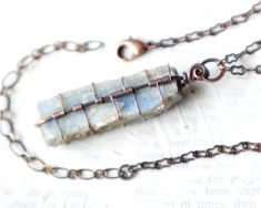 Wire Wrapped Raw Kyanite Pendant - Although blue #kyanite is a throat & 3rd eye chakra crystal, it works well on all chakras. Kyanite is used to assist meditative practice due to its protective properties, & its powers at enhancing psychic abilities. It is also used to treat blockages in throat #chakra in order to open & heal lines of communication & self-expression.   #kyanitejewelry #kyanitependant #kyanitenecklace #bluekyanite #rawcrystals #crystaljewelry #pendant #necklace #handmade…