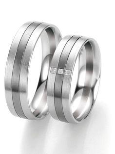 Eheringe in Graugold-Weißgold: -   Ringbreite: 6,0 mm -  Kollektionen: Fifty Rings Of Grey -  Steingröße & Qualität: ges. 0,023 ct tw/if -  Material: Graugold-Weißgold -  Ringhöhe: 1,8 mm -  Oberfläche: mattiert, glänzend -  Lieferzeit: 7-10 Werktage