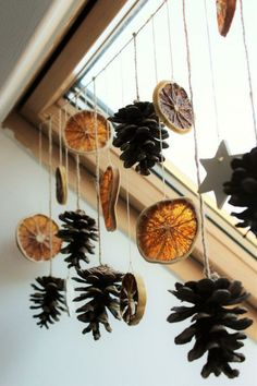 dried orange slices, several pine cones and star shapes, tied to a string and hanging from a ceiling window with wooden window pane Christmas decorations ▷ 1001 + Ideas for DIY Christmas Gifts and Festive Decoration Diy Christmas Gifts, Winter Christmas, Holiday Crafts, Christmas Time, Christmas Ornaments, Natural Christmas Decorations, Autumn Decorations, Christmas Ceiling Decorations, Orange Decorations
