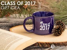 "This 13 oz. Blue ceramic camper style mug has ""Class of 2017"" printed in white on both sides of the mug."