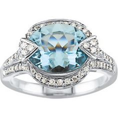 A 14K white gold fashion ring with 1 oval natural aquamarine. Surrounded by round bead set diamonds. .5 carats in diamonds and a 3.20 carat aquamarine. Love it!