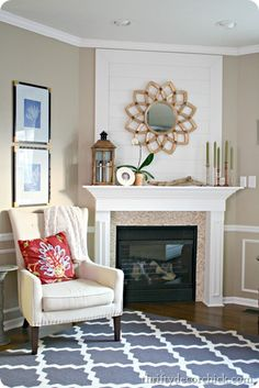 I like the chair Thrifty Decor Chick - wood plank wall fireplace starburst mirror Fireplace Remodel, Fireplace Wall, Living Room With Fireplace, Farmhouse Fireplace, Fireplace Ideas, Fireplace Design, Fireplace Mantels, Wood Plank Walls, Thrifty Decor Chick