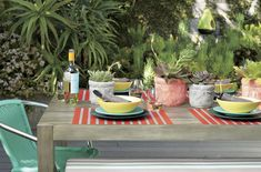 Colorful earthy table setting from CB2