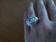 My first wire ring. Cool project! you'll need: wire, pliers, something you can use for measuring (mascara, marker, etc), 10 minutes