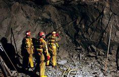 Miners in Underground Tunnel