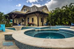 Cayman Structural Group Timber Frame design and construction, concrete back patio, pool with integrated seating with table and hot tub. via Houzz Grand Cayman Island, Cayman Islands, Custom Home Designs, Custom Homes, Swimming Pool Designs, Swimming Pools, Construction Services, Back Patio, Houzz