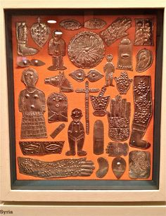 Alexandre Girard's collection of milagros, votives, nazars, and tamatas from all over the world.(Syria)|International museum of folk art, Santa Fe, New Mexico.