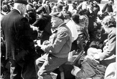 Amsterdam, Holland, 1943, People sitting on benches during deportation to Westerbork death camp.