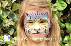 Blue Orange Images facepainting Watford, Girl face painted as a fantasy tiger design with gold glitter