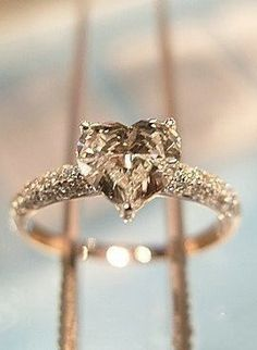 I usually don't like heart diamonds, but this gold heart diamond ring is beautiful!