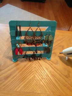 Earring holder made of popsicle sticks, all you need is some paint and a hot glue gun