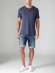 Shop this look on Lookastic: https://lookastic.com/men/looks/navy-crew-neck-t-shirt-navy-denim-shorts-white-low-top-sneakers/12664 — Navy Crew-neck T-shirt — Navy Denim Shorts — White Low Top Sneakers