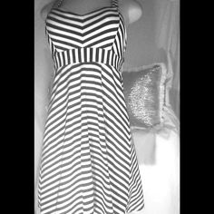 Cute Striped Dress Black and white striped, cross-back dress.Fairly new.. Candie's Dresses Midi