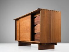 George Nakashima Two Sliding Door Cabinet in Walnut   From a unique collection of antique and modern credenzas at https://www.1stdibs.com/furniture/storage-case-pieces/credenzas/