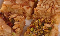Nammoura topped with pistachios, pine nuts, almonds, etc/ yummy Lebanese sweets with nuts, coconut and semolina