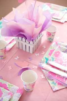 Butterfly confetti on tables in soft pink and white- perfect garden tea party