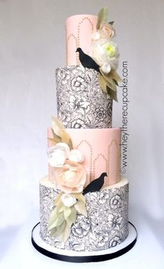 This wedding cake was inspired by the art nouveau period mixed with the influence of nature by way of wafer paper flowers & leaves. The couple loves doves so I included the black fondant silhouettes. The cake also includes over 1500 hand. Deco Wedding Cake, Wedding Cake Designs, Unique Cakes, Elegant Cakes, Gorgeous Cakes, Pretty Cakes, Amazing Wedding Cakes, Amazing Cakes, Fondant Cakes