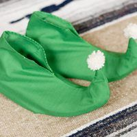 Dressing up as Santa's little helper is a fun way to fool the kids. But you have to have the costume exactly right so as not to arouse any suspicions. Don't forget your elf shoes, which you can whip up out of leftover costume fabric in a few minutes.