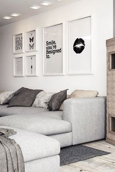Gray living room love black and white posters beige and grey tones wooden floor