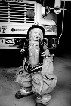 I took a picture like this in my Dads gear when I was younger! I love it! So cute!