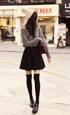 Creme pom pom beanie + grey knitted sweater + black skater skirt + half thigh high black tights + women dress shoes #KoreanFashion