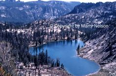Heart Lake is located in Idaho's Big Horn Crags, part of the Frank Church River of No Return Wilderness. Photo taken on backpacking trip in 1984. ©Copyright by Marty Nelson. Photo available to purchase on line: http://www.bigstockphoto.com/image-43915372/stock-photo-heart-lake-in-idaho-wilderness