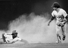 7/7/1976: Dick Allen arrives in a cloud of dust as he steals second base. 2B Davey Lopes retrieves the loose ball. (Dodgers 6, Phillies 5)