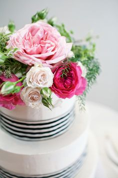 Pink Floral Cake Topper with navy striped ribbon around the tiers of the wedding cake