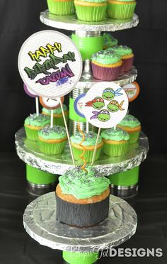 Teenage Mutant Ninja Turtle Party.  I love the idea of tin cans being used in the cake display.  Nice touch.