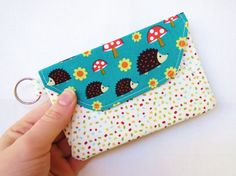 I love this family of hedge hogs! This pouch is great for holding my gift cards/change. Get your handmade pouch here: https://www.etsy.com/listing/223755683/pouch-hedgehog-pouch-coin-purse-coin?ref=shop_home_active_10