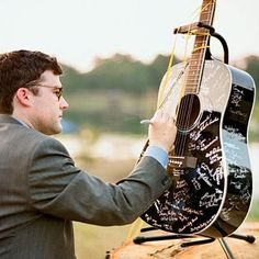 Guitar guestbook | For this music-loving couple, having guests sign a favorite instrument, like this guitar, is a great way to remember the day for years to come. | SouthernLiving.com