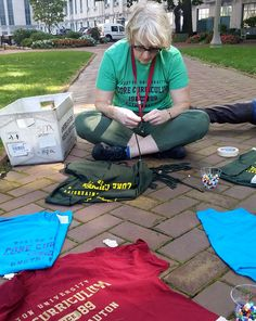 What does Core like to do besides read... and read... and read?  Decorate t-shirts, duh.  Here, Prof. Hamill threads her shirt with beads at the Core BBQ (visit our Life in Core board to see the finished product!).