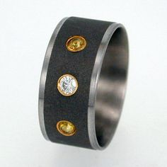 Titanium ring with flush-set diamond and sapphires, Johan Rust