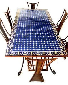 Moroccan dining mosaic table - for laundry table - maybe use same tile for interior and mosaics as border