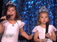 Sophia Grace & Rosie (who looks scared!) They like tiaras and pink tutus...