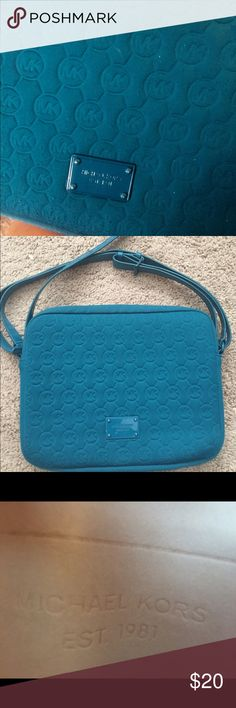 "Michael Kors teal tablet case 11"" X 9"" Michael Kors teal tablet case 11"" X 9"" with MK logo, Authentic, has some wear and small Stan on bottom Michael Kors Bags Crossbody Bags"