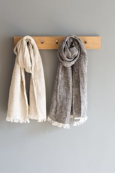 Loose weave linen scarf with a fringe at both ends.